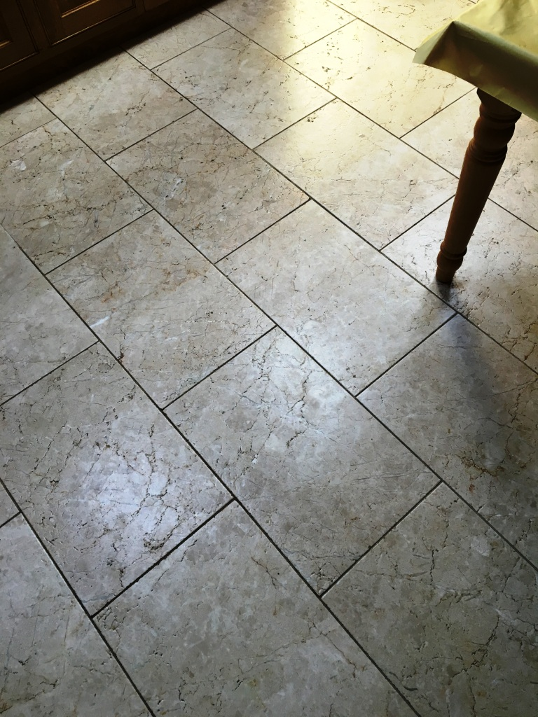 Tumbled Marble floor in Twickenham Before Cleaning